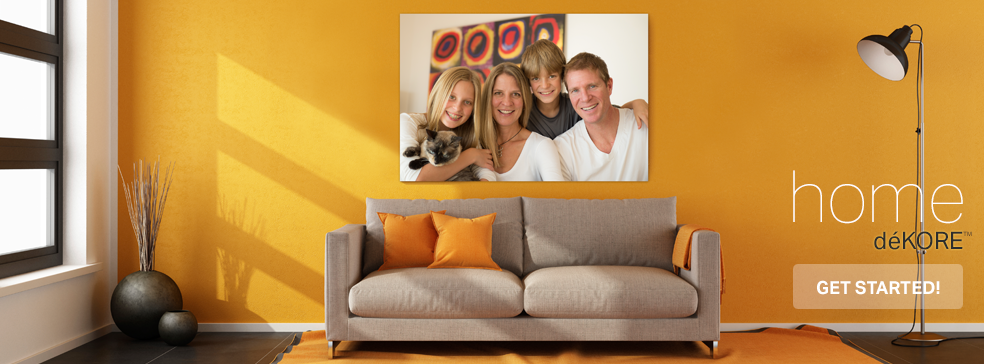 Large print canvas family portrait in home above orange couch