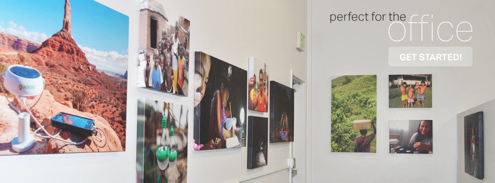 multiple large print canvas pictures in office